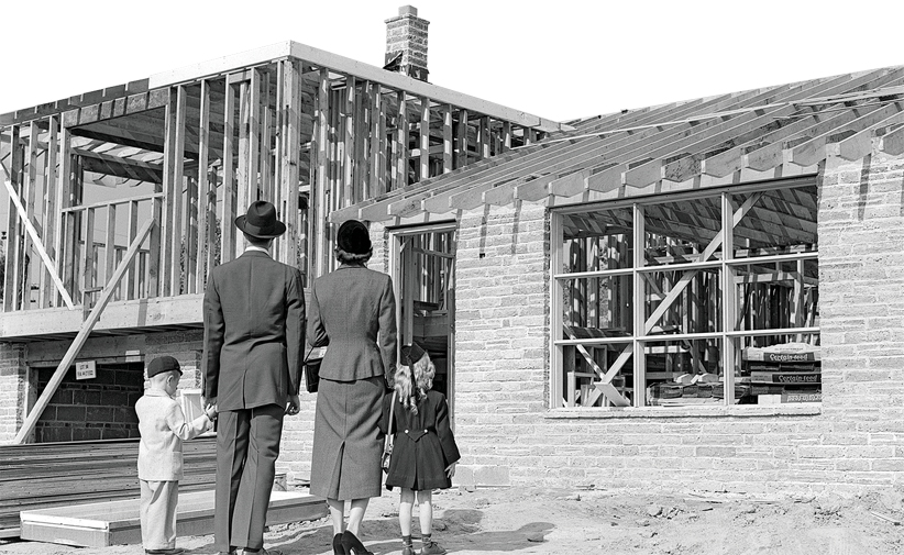 30 Aug 1955 --- 1950s Family Looking At New Home Under Construction --- Image by © H. Armstrong Roberts/ClassicStock/Corbis