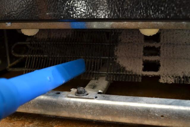 Cleaning fridge coils vaccuum